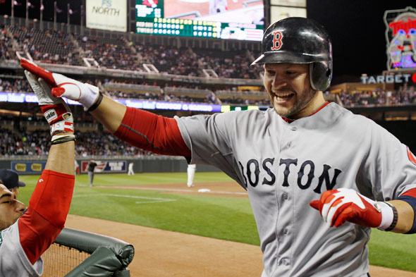 Boston Red Sox' Cody Ross celebrates his two-run, game-tying home run off Minnesota Twins pitcher Jason Marquis in the seventh inning of a baseball game Monday, April 23, 2012, in Minneapolis.