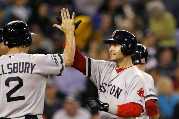 Cody Ross, right, is congratulated by Jacoby Ellsbury on Ross' three-run home run against the Seattle Mariners in the sixth inning of a baseball game Tuesday, Sept. 4, 2012, in Seattle.