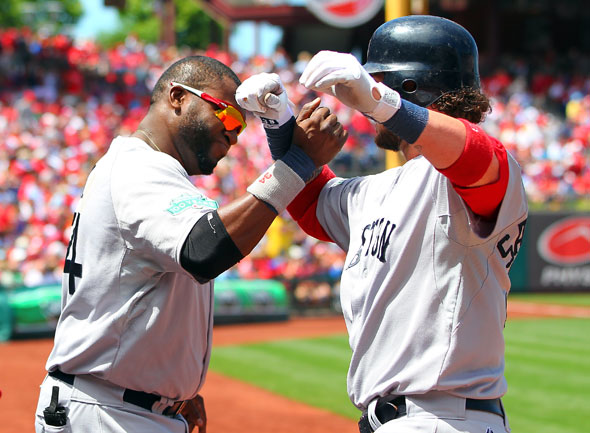 David Ortiz of the Boston Red Sox congratulates Jarrod Saltalamacchia after Saltalamacchia hit a home run against the Philadelphia Phillies in a MLB interleague baseball game on May 20, 2012 at Citizens Bank Park in Philadelphia, Pennsylvania.