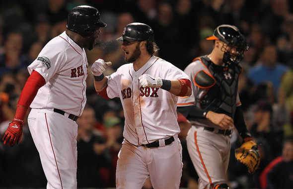 Jarrod Saltalamacchia of the Boston Red Sox celebrates his two-run home run with teammate David Ortiz as Matt Wieters of the Baltimore Orioles looks away in the ninth inning at Fenway Park June 5, 2012 in Boston, Massachusetts.