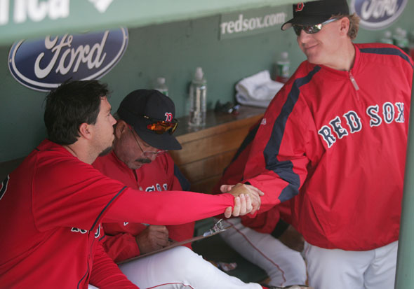 4/16/06   Red Sox starting pitcher Josh Beckett getting a hand shake from Curt Schilling after Beckett pitched 7 innings against the Mariners at Fenway Park on Sunday April 16, 2006. Matthew J. Lee, Globe staff