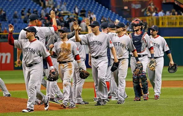 The Boston Red Sox celebrate a victory over the Tampa Bay Rays at Tropicana Field on May 17, 2012 in St. Petersburg, Florida.