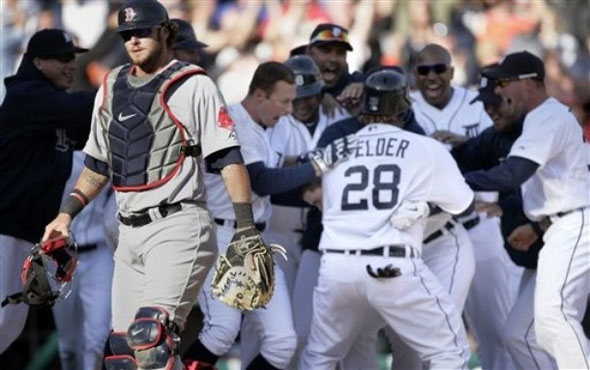 Boston Red Sox catcher Jarrod  Saltalamacchia walks off the field as Detroit Tigers celebrate a 13-12 win in 11 innings, after a baseball game Sunday, April 8, 2012, in Detroit.
