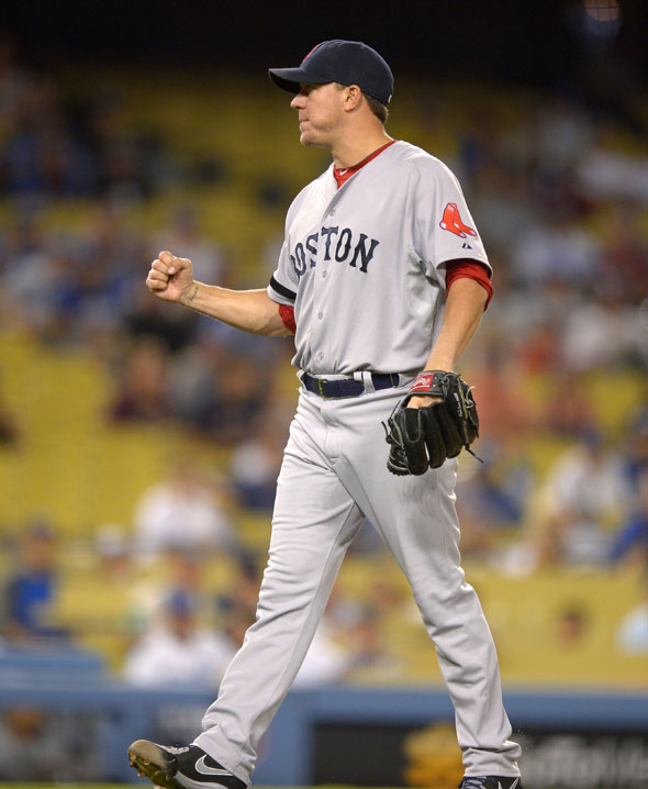 Red Sox starting pitcher Jake Peavy reacts as they defeat the Los Angeles Dodgers 8-1 in their game