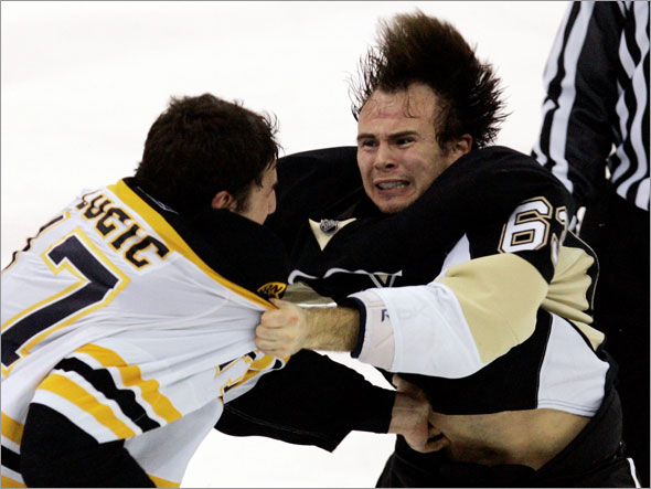 Pittsburgh Penguins' Tim Wallace, right, fights with Boston Bruins' Milan Lucic during the third period of an NHL hockey game in Pittsburgh on Tuesday, Dec. 30, 2008. The Bruins won 5-2.