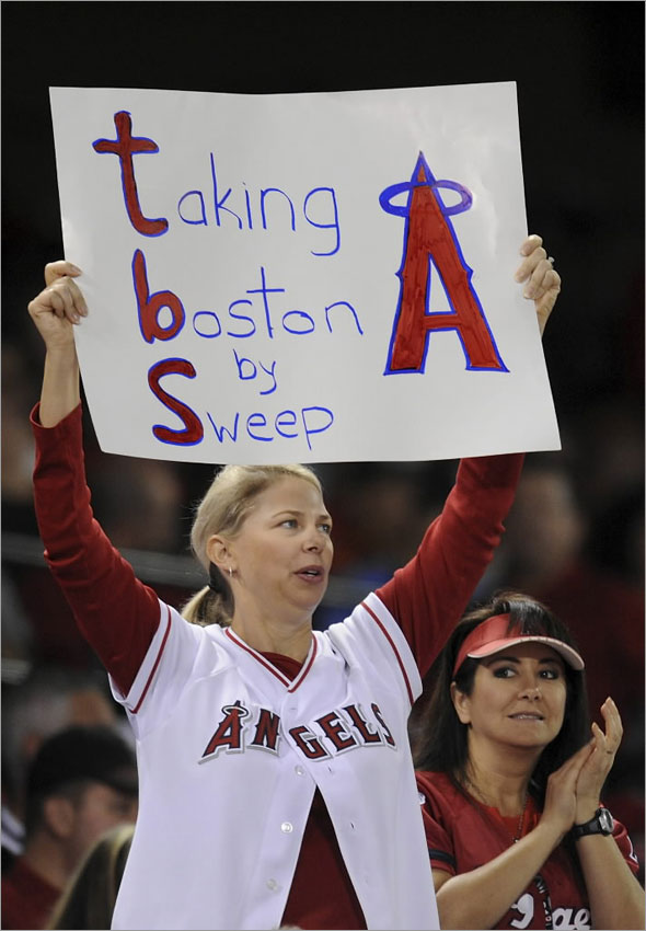 A fan of the Los Angeles Angels of Anaheim holds a sign in support during Game Two of the ALDS against the Boston Red Sox during the 2009 MLB Playoffs at Angel Stadium on October 9, 2009 in Anaheim, California.