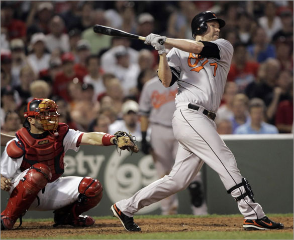 Baltimore Orioles' Aubrey Huff follows through on a swing against Boston Red Sox relief pitcher Hideki Okajima in the seventh inning of a baseball game at Fenway Park in Boston on Tuesday, June 10, 2008. Huff singled on the at-bat, and had four hits in the Orioles' 10-6 victory.