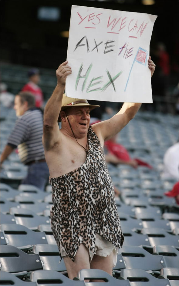 A fan holds a sign before the MLB American League Division Series playoff baseball game between the Los Angeles Angels and the Boston Red Sox in Anaheim, California October 9, 2009