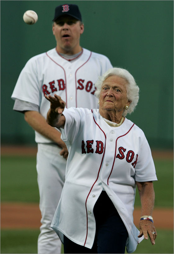Former First Lady Barbara Bush threw out a ceremonial first pitch prior to the game, as Red Sox pitcher Curt Schilling, who had escorted her to the mound looks on from behind.