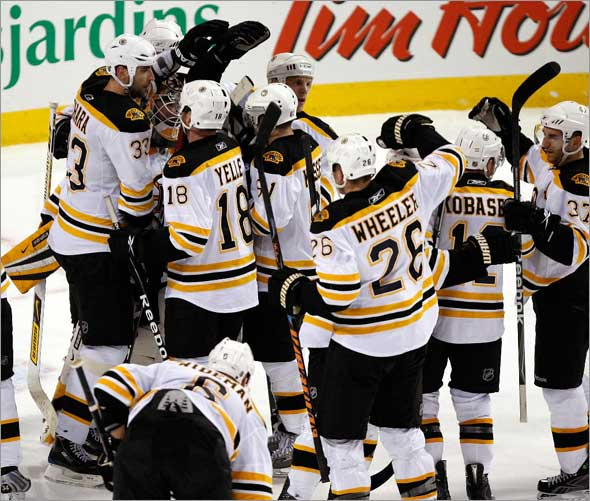 Boston Bruins goalie Tim Thomas and the Bruins celebrate after taking Game 3 putting the Canadiens on the brink of elimination facing a must win game on Wednesday.