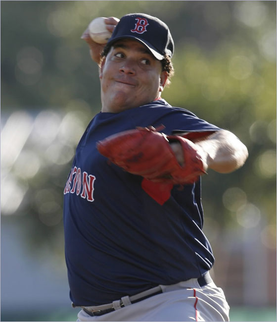 Red Sox pitcher Bartolo Colon throws a pitch to a batter during a live batting practice session at baseball spring training workouts at City of Palms Park in Fort Myers, Fla., Sunday, March 9, 2008. Colon is scheduled to see his first game action of the spring on Thursday.