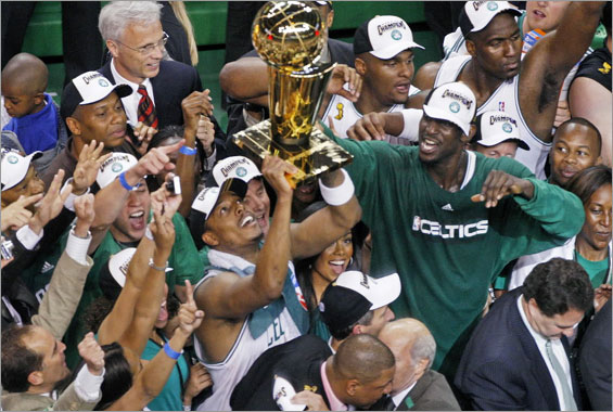 The Boston Celtics defeated the Los Angeles Lakers to win the NBA Finals four games to two, and in the process, wrapped up the franchise's seventeenth NBA Championship. Here Paul Pierce, with Kevin Garnett at right holds up the trophy.