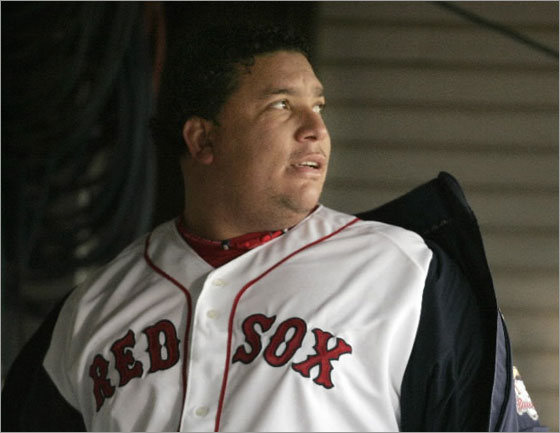 Bartolo Colon glances toward the field as he steps into the dugout before pitching for the Pawtucket Red Sox in the team's home opener minor league baseball game against the Indianapolis Indians, in Pawtucket, R.I., Thursday, April 3, 2008.