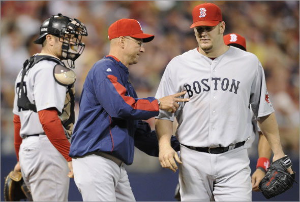 Red Sox manager Terry Francona removes Brad Penny, right, in the sixth inning of a baseball game against the Minnesota Twins, Monday, May 25, 2009, in Minneapolis. Red Sox won 6-5. Penny (5-1) pitched his third straight victory.