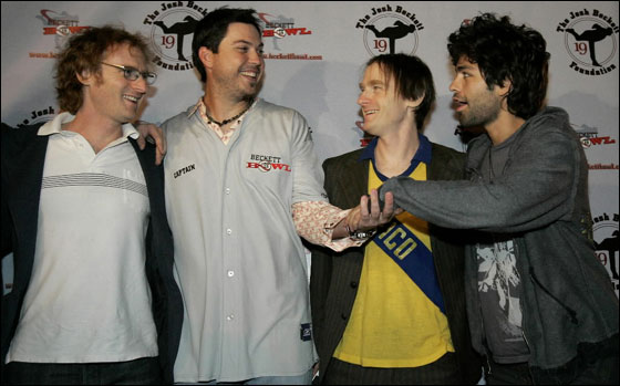 Red Sox pitcher Josh Beckett shakes hands with actor and Honey Brothers band member Adrian Grenier as fellow band members Ari Gold and Ethan Gold look on at the inaugural Beckett Bowl at Town Line Lanes in Malden