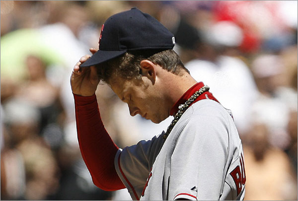 Clay Buchholz reacts after Chicago White Sox's Jermaine Dye hit a solo home run during the second inning of a baseball game Sunday, Aug. 10, 2008 in Chicago.