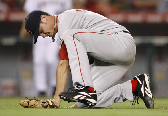 Red Sox starting pitcher Clay Buchholz reacts after being struck by a ball hit by Anaheim Angels' Vladimir Guerrero during the fifth inning of their MLB American League baseball game in Anaheim, California July 18, 2008.