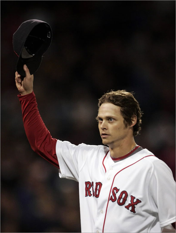 Clay Buchholz tips his cap to the crowd as he comes out of the game in the ninth inning