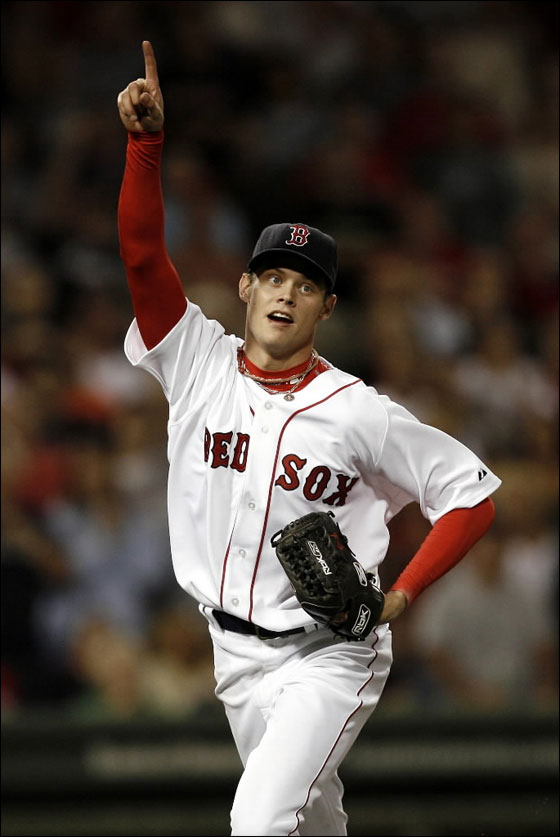 Red  Sox pitcher  Clay Buchholz points toward a pop-up to teammate Kevin Youkilis during the seventh inning against the Baltimore Orioles in a baseball game at Fenway Park in Boston on Saturday, Sept. 1, 2007.