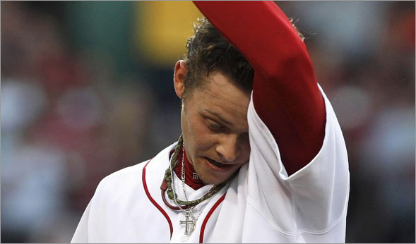 Boston Red Sox pitcher Clay Buchholz walks off the field after a rough 1st inning giving up 2 runs in his 1st start since coming back up from Pawtucket.
