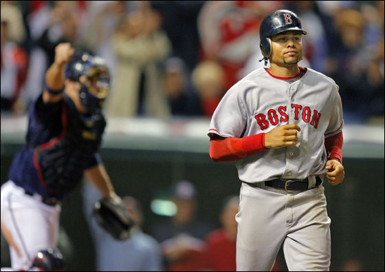 Cleveland, Ohio: Indians catcher Kelly Shoppach rejoices in the background after the Red Sox Coco Crisp lined out to first base to end the game.