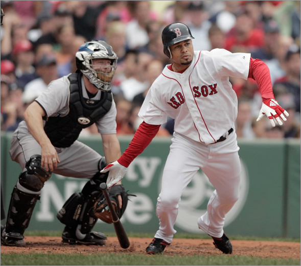 Boston Red Sox's Coco Crisp, right, hits an RBI-single in front of Toronto Blue Jays catcher Gregg Zaun, left, in the second inning of a baseball game, Sunday, Sept. 14, 2008, in Boston. The Red Sox won 4-3.