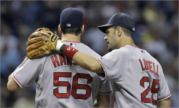 Red Sox third baseman Mike Lowell, right, talks with pitcher Craig Hansen after he surrendered the lead to the Tampa Bay Rays during the seventh inning of a baseball game Wednesday, July 2, 2008, in St. Petersburg, Fla.