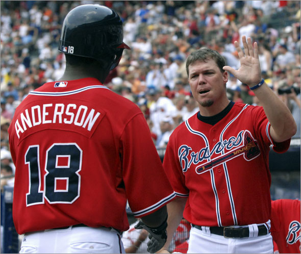 Chipper Jones, right, celebrates with teammate Garret Anderson after Anderson's home run against the Boston Red Sox during the fourth inning of a baseball game Sunday, June 28, 2009, at Turner Field in Atlanta. Both players had solo home runs during the afternoon and led the Braves to a 2-1 win.