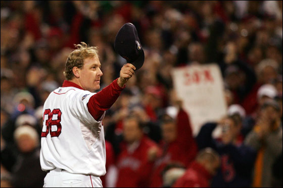 Curt Schilling of the Boston Red Sox tips his hat to the crowd as he comes out of the game in the sixth inning against the Colorado Rockies during Game Two of the 2007 Major League Baseball World Series at Fenway Park on October 25, 2007 in Boston