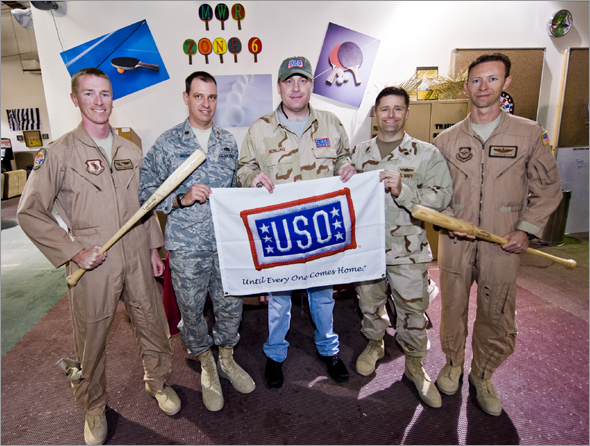 Six-time major league baseball All-Star Curt Schilling poses for a photo with troops as part of a week-long USO tour to the Persian Gulf. Taking the mound to extend America�s well wishes, Schilling will visit and shake hands with troops, sign autographs and pose for pictures.