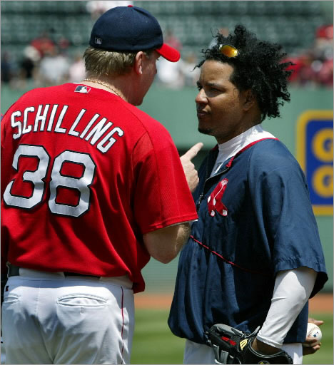 7-11-2004: Prior to the Red Sox-Rangers game, during batting practice, pitcher Curt Schilling (left) had a rather long, animated conversation with teammate Manny Ramirez (right), who asked out of the starting lineup, sighting a hamstring problem.