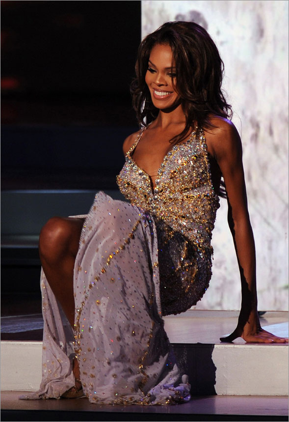 Crystle Stewart, Miss USA 2008, falls down on stage as she appears in her costume among the top 10 at the final of the 57th Miss Universe contest held on July 14, 2008 at the central coastal resort city of Nha Trang.