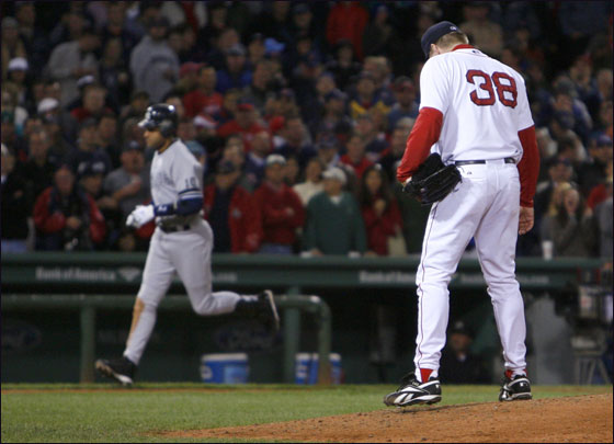 Derek Jeter of the New York Yankees goes for a three-run home run against pitcher Curt Schilling of the the Boston Red Sox  at Fenway Park on September 16, 2007 in Boston, Massachusetts.