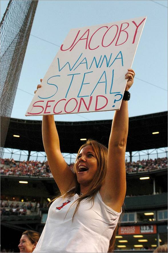 A fan holds up a sign during the game between the Boston Red Sox and the Baltimore Orioles August 20, 2008 at Camden Yards in Baltimore, Maryland.