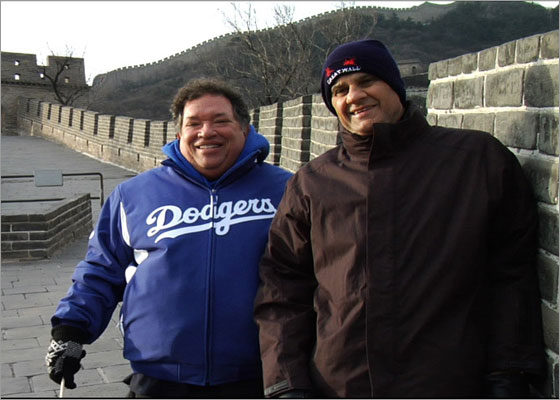Dodgers marketing guru Dr. Charles Steinberg with skipper Joe Torre on the Great Wall of China.