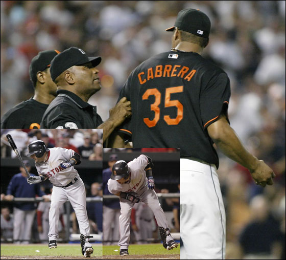 Baltimore Orioles starting pitcher Daniel Cabrera (R) is held back by umpire Laz Diaz and Orioles shortstop Miguel Tejada after both benches cleared and came out on the field after Cabrera threw a pitch over Boston Red Sox batter Dustin Pedroia in the fourth inning of their MLB American League baseball game in Baltimore, Maryland September 7, 2007