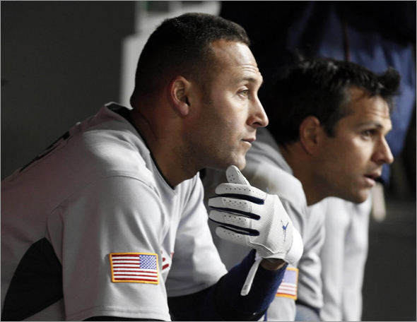 Team USA's Derek Jeter sits in the dugout during the ninth inning of their semifinals of the World Baseball Classic against Team Japan in Los Angeles, California March 22, 2009. Team Japan defeated Team USA.
