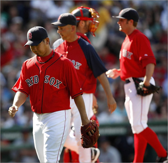 Red Sox pitcher Daisuke Matsuzaka leaves the mound after only lasting an inning and a half in his first start since going on the disabled list.  Matsuzaka was relieved by pitcher Chris Smith.