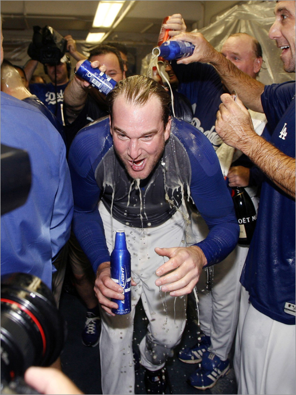 Los Angeles Dodgers pitcher Derek Lowe celebrates in the club house after sweeping the Chicago Cubs to win Game 3 of their MLB National League Divisional Series playoff baseball game in Los Angeles, October 4, 2008.