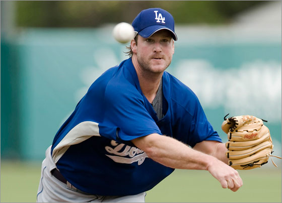 Los Angeles Dodgers starter Derek Lowe throws from the mound during the first inning of a spring training baseball game against the Boston Red Sox in Fort Myers