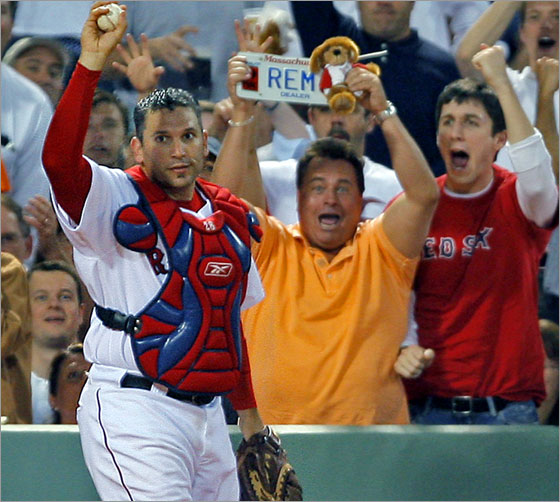 05/15/2007: Red Sox catcher Doug Mirabelli made a nice play on a fifth inning foul ball off the bat of Detroit's Gary Sheffield, as he battled the fans (A), had the ball pop out of his mitt, but he caught it barehanded after it came out (B), and he held it up foir the umpire (and the astonished fans) to see (C).