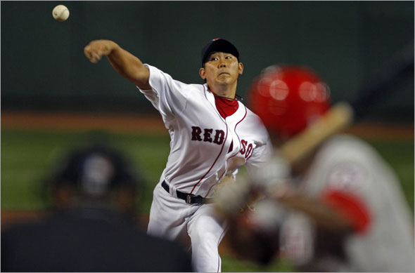 Red Sox pitcher Daisuke Matsuzaka made his return to the mound tonight after a nearly two month absence. Here he fires a first inning pitch to Angels leadoff batter Chone Figgins. The Boston Red Sox play the Los Angeles Angels of Anaheim at Fenway Park.