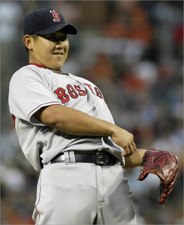 Daisuke Matsuzaka reacts after walking Baltimore Orioles batter Luke Scott in the second inning of their MLB American League base baseball game in Baltimore, Maryland August 19, 2008.