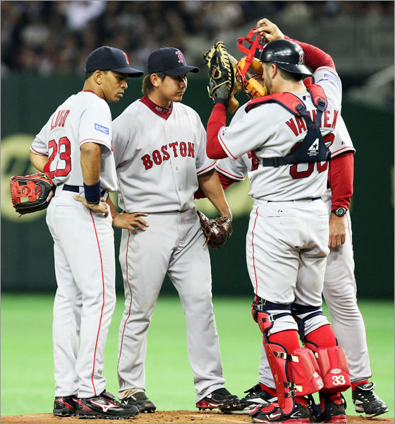 Pitcher Daisuke Matsuzaka talks to teammates in the second innings during the MLB Opening Series between Boston Red Sox and Oakland Athletics at Tokyo Dome on March 25, 2008 in Tokyo, Japan.
