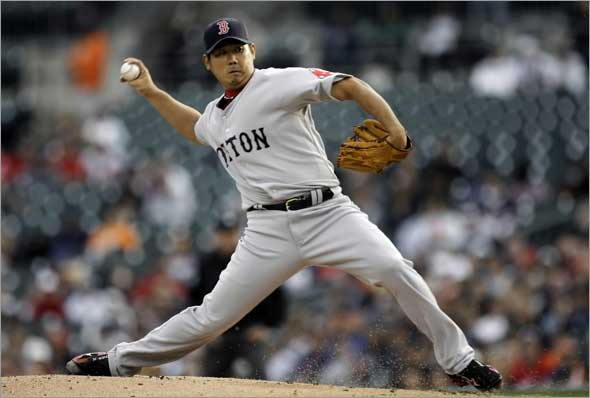 Red Sox pitcher Daisuke Matsuzaka, of Japan, throws against the Detroit Tigers in the first inning of a baseball game in Detroit, Tuesday, June 2, 2009.