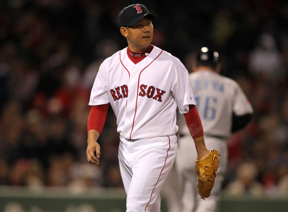 Red Sox Pitcher Daisuke Matsuzaka walks off field after getting out of the 6th inning of of play. The Boston Red Sox's Vs Toronto Blue Jays.