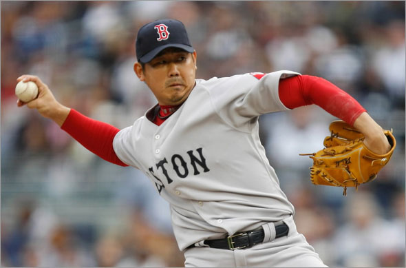 Daisuke Matsuzaka #18 of the Boston Red Sox pitches against the New York Yankees during the game on September 26, 2009 at Yankee Stadium in the Bronx borough of New York City.