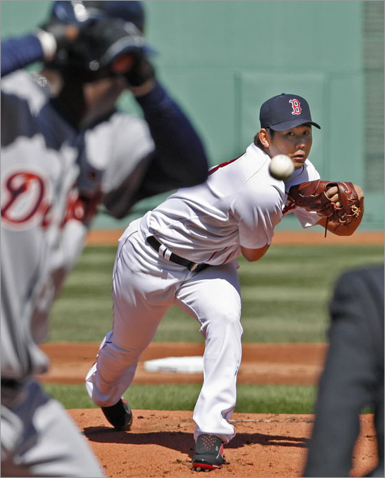 Red Sox starting pitcher Daisuke Matsuzaka fires the first pitch of the Fenway Park season to the Tigers Edgar Renteria.