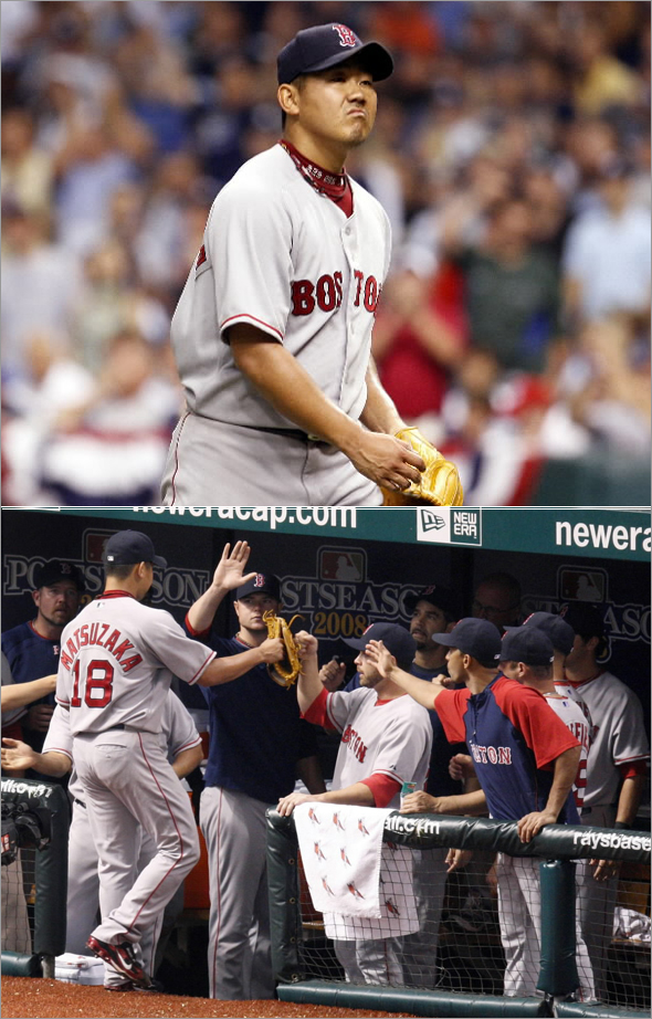 Red Sox pitcher Daisuke Matsuzaka heads to the dugout after pitching the seventh inning of game one of the American League Championship series  against the Tampa Bay Rays at Tropicana Field in St. Petersburg, Florida October 10, 2008.
