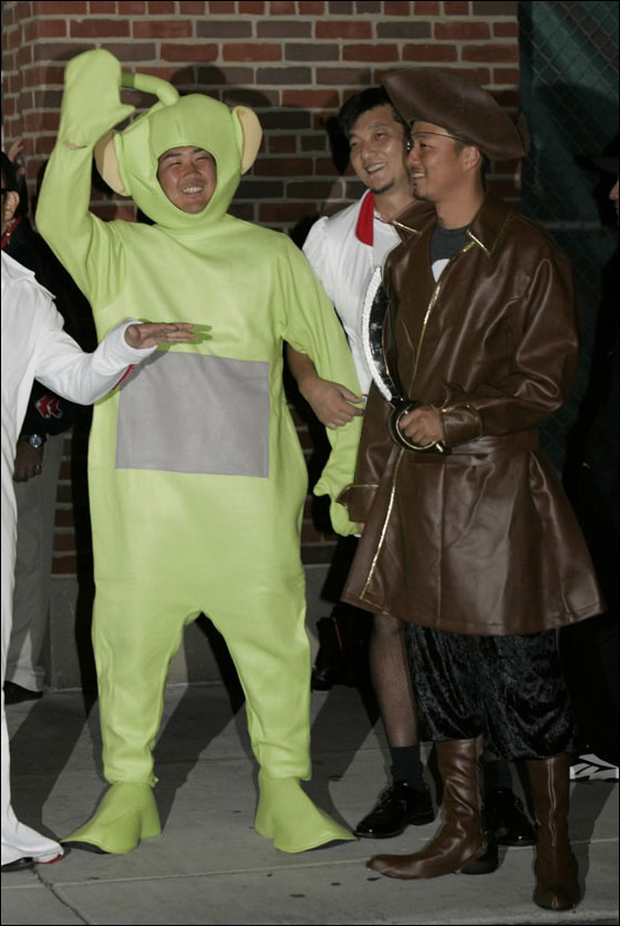 Red Sox pitchers Daisuke Matsuzaka, left in Teletubby costume, and Hideki Okajima, right in pirates costume, are seen after a game at Fenway Park in Boston Sunday, Sept. 16, 2007 before leaving for Toronto. Many teams use a late season trip as a chance to have some fun with the rookies, dressing them in outlandish costumes that must be worn on a road trip
